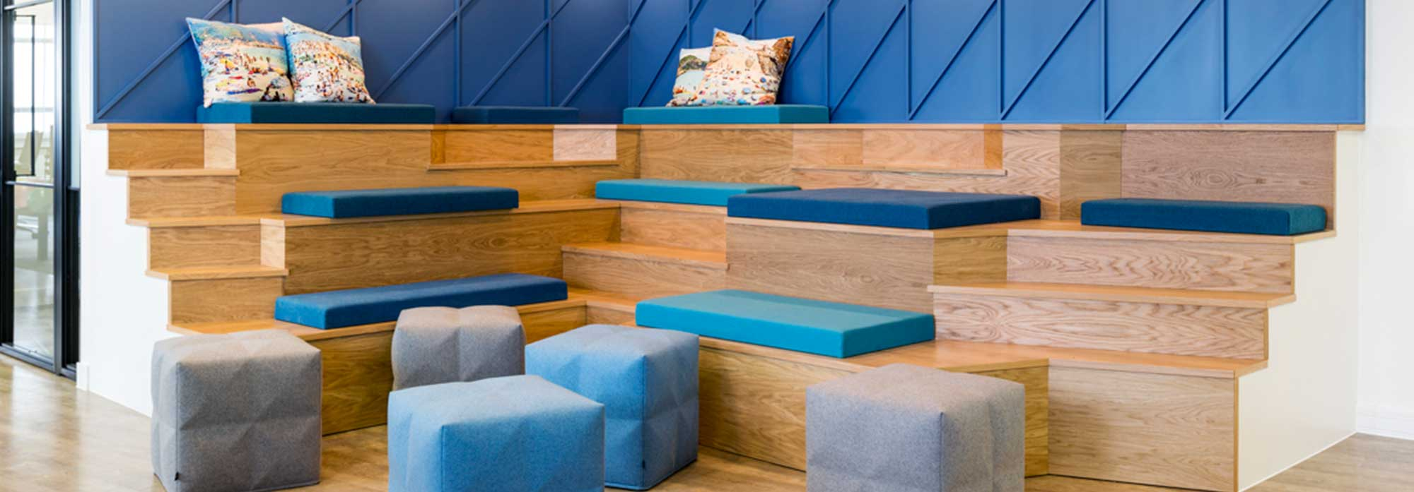 Pops of blue colour on natural wood bleachers